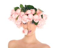 Young woman in a hat of roses isolated on white Royalty Free Stock Photos