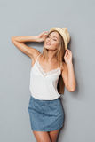 Young woman in hat and skirt with eyes closed Royalty Free Stock Photography