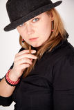 Young woman with hat is smoking a cigar Royalty Free Stock Images
