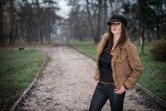Young woman with hat standing and posing. Young woman standing and posing Stock Images