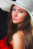 Young woman in a hat, studio Stock Photography