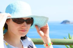 Young woman in hat and sunglasses Royalty Free Stock Image