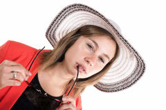 Young woman with a hat and sunglasses Stock Image