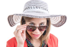 Young woman with a hat and sunglasses Royalty Free Stock Photos