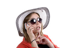 Young woman with a hat and sunglasses phone Stock Photo