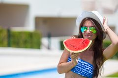Young woman in hat and sunglasses with watermelon Stock Photos