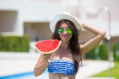 Young woman in hat and sunglasses with watermelon Stock Photo