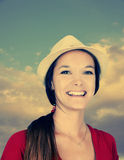 Young woman with hat-toned. Beautiful young woman with hat and cloudy sky, filter effect Royalty Free Stock Photos
