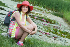 Young woman with hat and water lilies in a lake Royalty Free Stock Photography