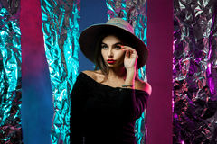 Young woman in hat with wide brim Stock Photo