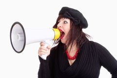 Young Woman with Hat Yelling in Megaphone Royalty Free Stock Photography