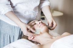 Young woman have face treatment at beauty clinic Royalty Free Stock Photos
