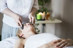Young woman have face treatment at beauty clinic Stock Photography