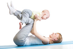 Young woman have fun with her son doing yoga Royalty Free Stock Photos