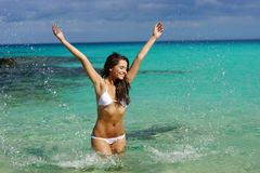 Young woman have fun in water Stock Images