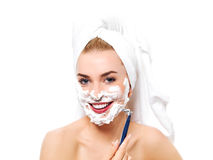 Young woman have morning shave Stock Photo