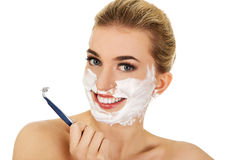 Young woman have morning shave. stock photography