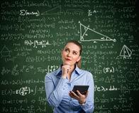 Young woman have problem with mathematics. Young woman holding calculator and have problem with mathematics stock photos
