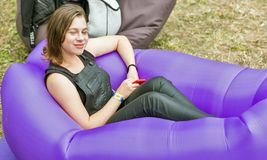 Young woman have a rest . Atlas Weekend Festival, Kiev, Ukraine royalty free stock photo