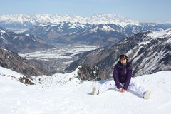 Young woman have a rest on the ski slope. Royalty Free Stock Photography