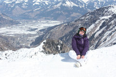 Young woman have a rest on the ski slope. Royalty Free Stock Photo