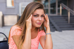 Young woman have a terrible headache. It can be migraine. Royalty Free Stock Photo