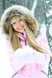 Young Woman Having A Walk In Winter Forest Stock Photo