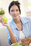 Young woman having apple for breakfast Stock Image