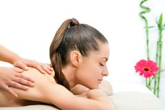 Young woman having back massage. Royalty Free Stock Photos