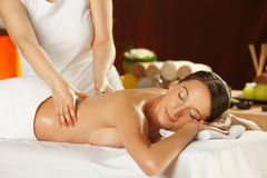 Young woman having a back massage Stock Photos