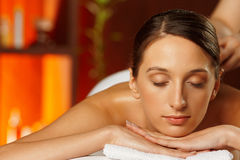 Young woman having a back massage Royalty Free Stock Images