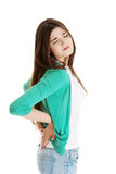 Young woman is having back pain. Isolated on white Royalty Free Stock Photos
