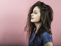 Young woman having bad hair day. Photo of a beautiful young woman with long hair having a bad hair day Royalty Free Stock Photography