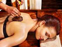 Woman having Ayurvedic body  spa massage. Stock Photos
