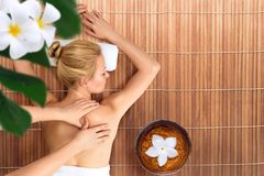 Young woman relaxing with massage in spa Stock Photography