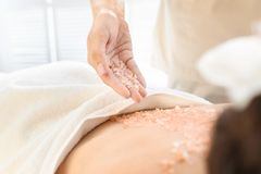 Young woman having body scrubbing procedure Royalty Free Stock Photo