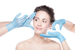 Young woman having botox face injections. Aesthetic medicine. Young beautiful woman is having botox face injections. Anti-aging skincare and plastic surgery Stock Photo