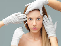 Young woman having botox injection Royalty Free Stock Photos