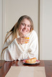 Young woman having breakfast Royalty Free Stock Image