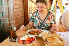 Young woman having breakfast. In street cafe stock photos