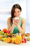 Young woman having breakfast. Balanced diet.  Stock Photos