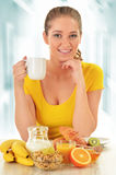 Young woman having breakfast. Balanced diet.  stock photography