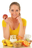 Young woman having breakfast. Balanced diet Royalty Free Stock Photos