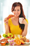 Young woman having breakfast. Balanced diet Stock Images