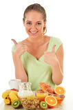 Young woman having breakfast. Balanced diet.  Royalty Free Stock Images