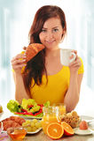 Young woman having breakfast. Balanced diet Stock Image
