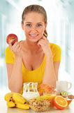 Young woman having breakfast. Balanced diet Royalty Free Stock Images