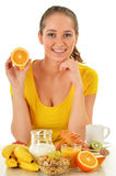 Young woman having breakfast. Balanced diet Stock Photography