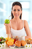 Young woman having breakfast. Balanced diet Royalty Free Stock Photography