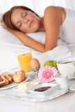 Young woman having breakfast in bed Stock Photos